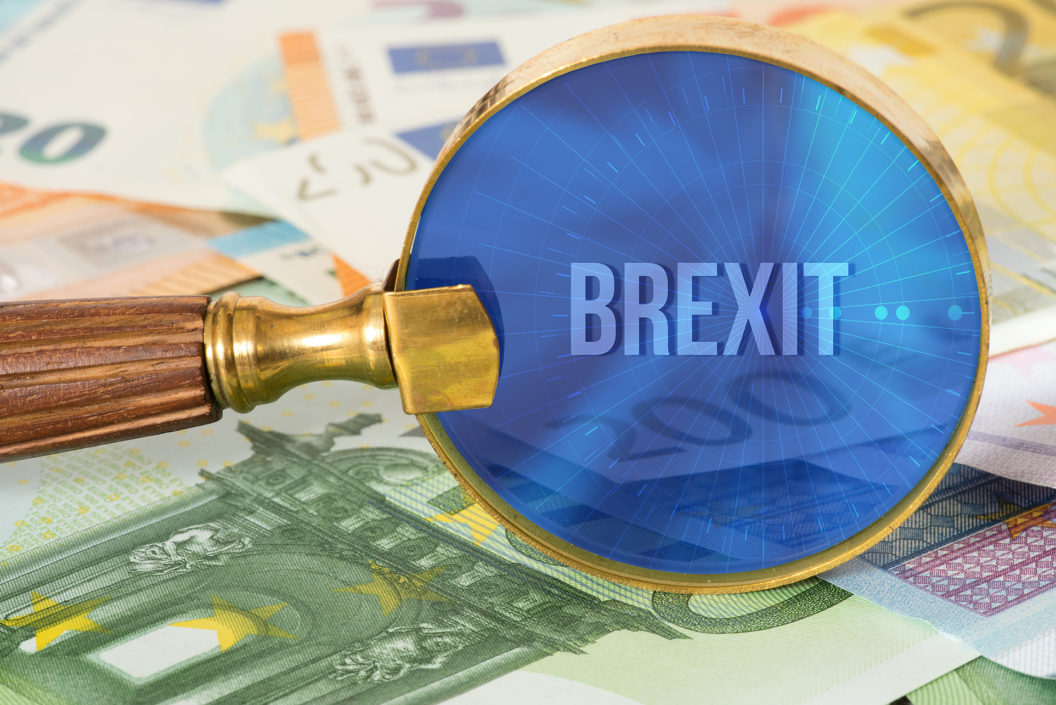 Brexit magnify glass currency